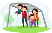 Family with Kids on Playing on a Monkey Bar — Stock Photo