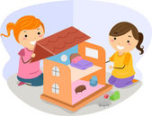 Girls Playing with a Dollhouse — Stock Photo
