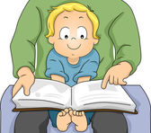 Toddler Boy Reading a Book with his Father — Stockfoto
