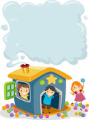 Kids on a Playhouse with Smoke on the Chimney — Stock Photo