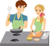 Couple Cooking with Matching Aprons — Stock Photo