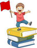 Kid Boy Standing on Pile of Big Books waving a Red Flag — Stock Photo