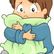 Stock Photo: Kid Boy Crying while Hugging a Pillow