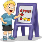 Kid Boy Placing an Apple on Board — Stock Photo