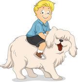 мальчик езда на спине собаки — Стоковое фото