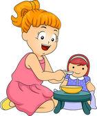 Little Girl Feeding Her Doll — Stock Photo