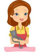 Pet Shop Employee Cuddling Cat — Stock Photo