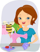Girl Sewing Baby Costumes — Stock Photo