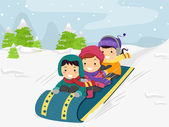 Kids Riding on a Snow Sled — Stock Photo