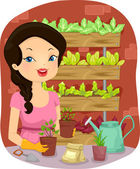 Girl Tending to Her Vertical Garden — Stock Photo