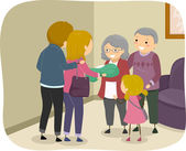Family Visiting an Elderly Couple — Stock Photo