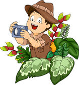 Boy in a Safari Outfit Holding a Camera — Stock Photo