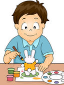 Boy Painting a Rabbit Figurine — Stock Photo