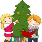 Kids Decorating a Christmas Tree — Stock Photo #7601660