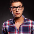 Young casual man wearing glasses and looking up — Stock Photo #12561434