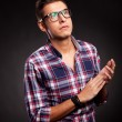 Young casual man with eyeglasses clapping — Stock Photo #12561436