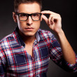Young casual man putting on his sunglasses — Stock Photo #12561437