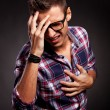 Young man doing a frustration gesture — Stock Photo #12561440