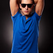 Young casual man posing with his hands behind his head — Stock Photo #12561446