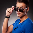 Young casual man with eyebrow raised — Stock Photo #12561455