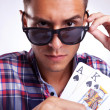A young man showing his poker pair — Stock Photo