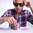 Stock Photo: Young poker player raises bet