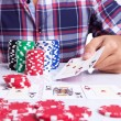 Gambler shows winner poker hand — Stock Photo #12561469