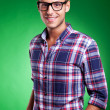 Young casual man posing on green — Stock Photo #12561481