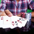 Cropped image of a winning four aces poker hand — ストック写真