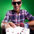Young casual man showing his poker hand — Stock Photo #12561489