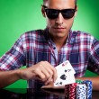 Young casual man and his strong poker hand — Stock Photo #12561491
