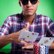 Young casual poker player throwing a pair of aces — Stock Photo