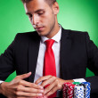 Poker player looking at his cards — Stock Photo #12561496
