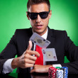 Poker player throwing two ace cards — Stock Photo #12561497
