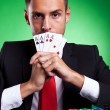 Card player covering his mouth with four aces — Stock Photo