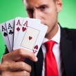 Young business mshowing four of kind hand of aces — Stock Photo #12561501