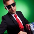 Business man playing with poker face - Stock Photo