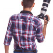 Professional male photographer holding his camera — Stockfoto