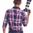 Professional male photographer holding his camera — 图库照片