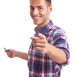 Young man presenting and pointing — Stock Photo #12561559