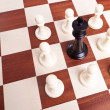King surrounded by pawns - Stock Photo