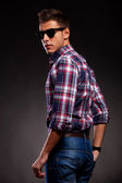 Young casual man with shades, looking at the camera — Stock Photo
