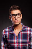 Young casual man wearing glasses and looking up — Stock Photo