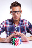 Young poker player with eyeglasses going all in — Stock Photo