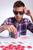 Young poker player raises the bet — Stock Photo