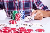 Gambler shows winner poker hand — Stock Photo