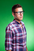 Young man model posin in a squared shirt — Stock Photo