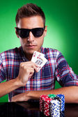 Young poker player showing high pair of hearts — Stock Photo