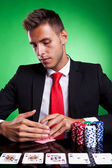 Poker player looking at his cards — Stock Photo