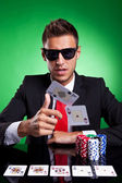 Poker player throwing two ace cards — Stock Photo